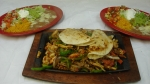 Fajita Casa Blanca (Double) - Tender strips of steak, beef, shrimp, chicken and chorizo (Mexican sausage). Served with rice, beans, salad, and one cheese quesadilla.